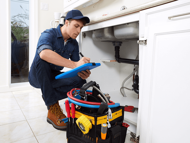 Plumber fixing kitchen leaks in Delray Beach, Florida